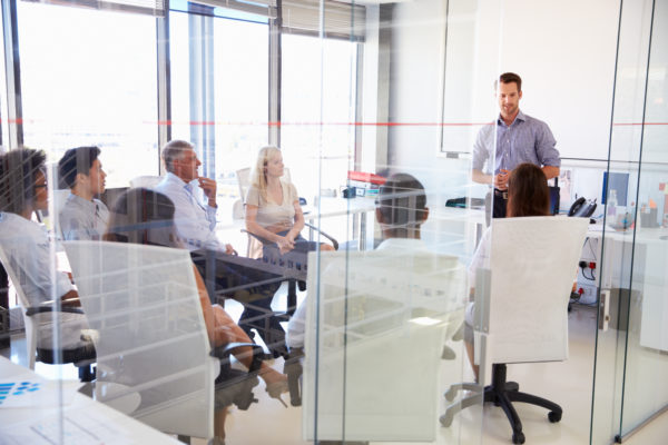 meeting in a glass wall room